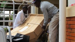 Unpacking new delivery bed - a fantastic fundraising result