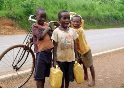 Children will help with daily chores including collecting water from the nearest water pump. Bicyles, which are often to big for them, can be used to transport the full jerry cans on foot