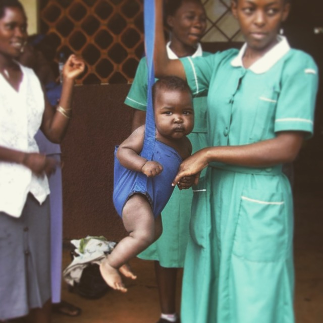 Postnatal Care weighing a baby