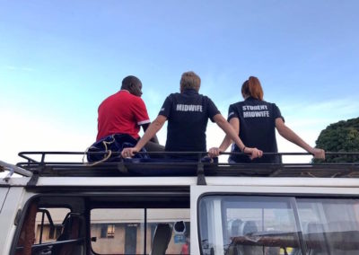 Relaxing on the roof top with Fred our driver after a busy outreach clinic, waiting to start the journey home